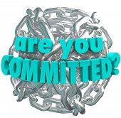The question Are You Committed in words on a ball of shiny silver metal chain links to illustrate de
