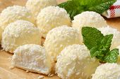 white chocolate pralines with creamy filling and sprinkled with coconut
