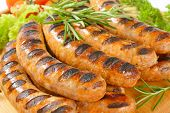 picture of grilled sausage  - grilled sausages with burned grid - JPG