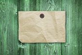 Empty Yellow Paper Ad Hanging On Green Vintage Wooden Wall