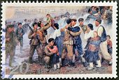 A stamp printed in North Korea shows soldiers reuniting with families
