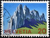 A stamp printed in Switzerland shows kreuzberge (Alpstein) Swiss Alps