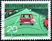 A stamp printed in the Federal Republic of Germany shows car with flashing rear after overtaking