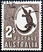 A stamp printed in Australia shows a Crocodile with the inscription