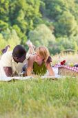Couple Picnicking In Park