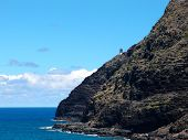 Makapu'u Lighthouse On Cliffside Mountain Top With Stretching Blue Pacific Ocean Below