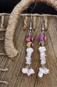 Hnadcrafted Earrings On Rustic Background