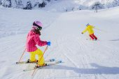 Ski, skiers on ski run - female skiers skiing downhill,  child on ski lesson
