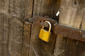 Padlock on an old wooden barn door