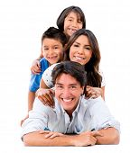 Happy family portrait lying on the floor - isolated over a white background