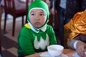 The boy disguise oneself as a batman with green clothes