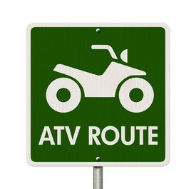 picture of four-wheelers  - An American road sign isolated on white with a symbol of an ATV and words ATV Route Places to ride ATV - JPG