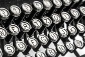 stock photo of qwerty  - Black and white close-up view of an old typewriter keys
