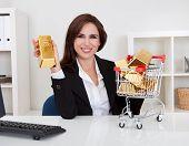Businesswoman Presenting Gold Bars