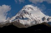 picture of trinity  - Majestic mount against the blue sky with roll cumulus is Kazbek  - JPG
