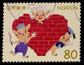 JAPAN - CIRCA 2012: A stamp printed in Japan shows three little pigs, circa 2012