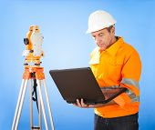 pic of theodolite  - Portrait of Senior land surveyor working with theodolite at construction site - JPG