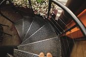 foto of spiral staircase  - black circular metal staircase with handrails and foot - JPG