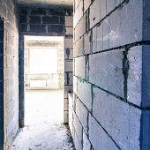 Corridor of grey large brick walls