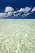 Sandy, shallow, tropical water in lagoon.