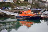 picture of outboard engine  - lifeboat reflected in the water of Brixham harbour - JPG