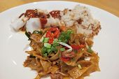 picture of soy sauce  - Char Kway Teow Stir Fry Sweet Soy Sauce Wide Noodles with Stick Rice and Rice Noodle Dish Closeup