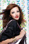 Portrait of a beautiful modern girl holding shopping bag