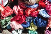 Collection Of Multi Colored Skeins Of Embroidery Cotton