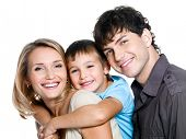 Portrait of happy young family with son - on white background