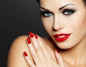 Photo of  woman with fashion red nails and sensual lips - Model posing in studio