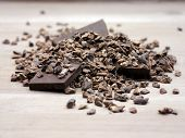 stock photo of cocoa beans  - Raw crushed organic cocoa beans with chunks of pure chocolate - JPG