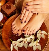 foto of legs feet  - Closeup photo of a female feet at spa salon on pedicure procedure - JPG