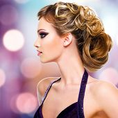 Profile portrait of  woman with fashion  hairstyle over creative background
