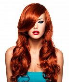 Portrait  of beautiful  woman with long red hairs and red lips. Calm face  of adult pretty girl, iso