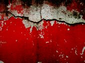vintage red and white cracked cement wall