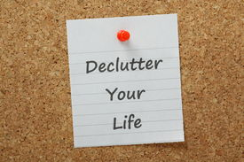 stock photo of productivity  - The phrase declutter your life typed on a piece of lined paper and pinned to a cork notice board - JPG