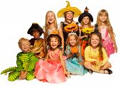 Large group of kids in costumes isolated on white