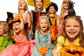 Happy kids wearing Halloween costumes close-up