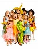 Many kids stand in Halloween costumes together