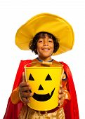 Boy in costume with Halloween spooky candy bucket