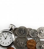 Pocket watch and coins on plain background. Time is money concept