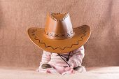 stock photo of baby cowboy  - Sweet Sleeping Baby In A Cowboy Hat