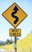 image of mile  - Winding road next 3 miles warning road sign - JPG