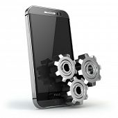 Mobile phone and gears on white isolated background.