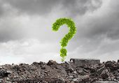 Conceptual image with green question mark growing on ruins