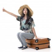 Asian young traveling woman hitchhiking, full length portrait isolated on white.
