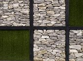 Artificial Grass  And Stone Wall As Background