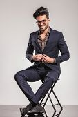 picture of button down shirt  - Fashion man in leather jacket looking down - JPG