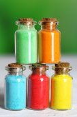 pic of pigment  - Bottles with colorful dry pigments on bright background - JPG