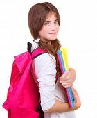 Side view of cute brunette schoolgirl with big pink schoolbag and holding in hands colorful textbook